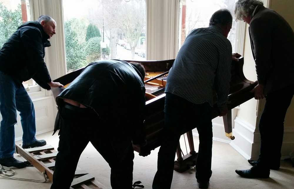Turning the piano over