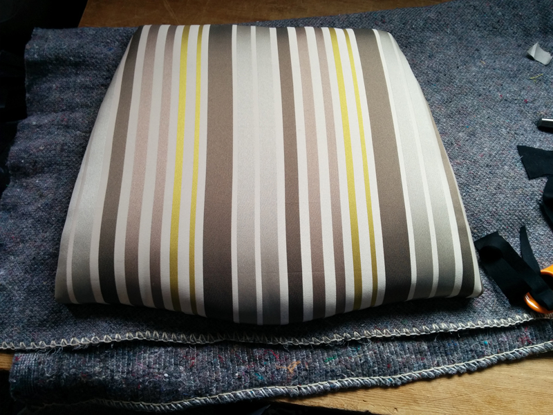 Finished upholstered seat pad.