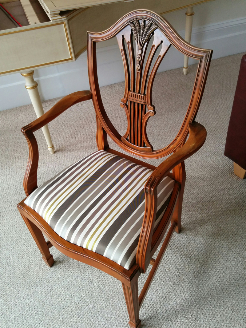 The finished chair with reupholstered seat.