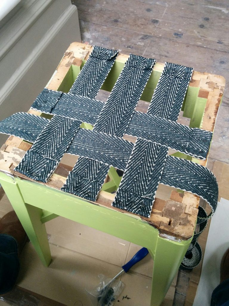 Adding the webbing to the stool