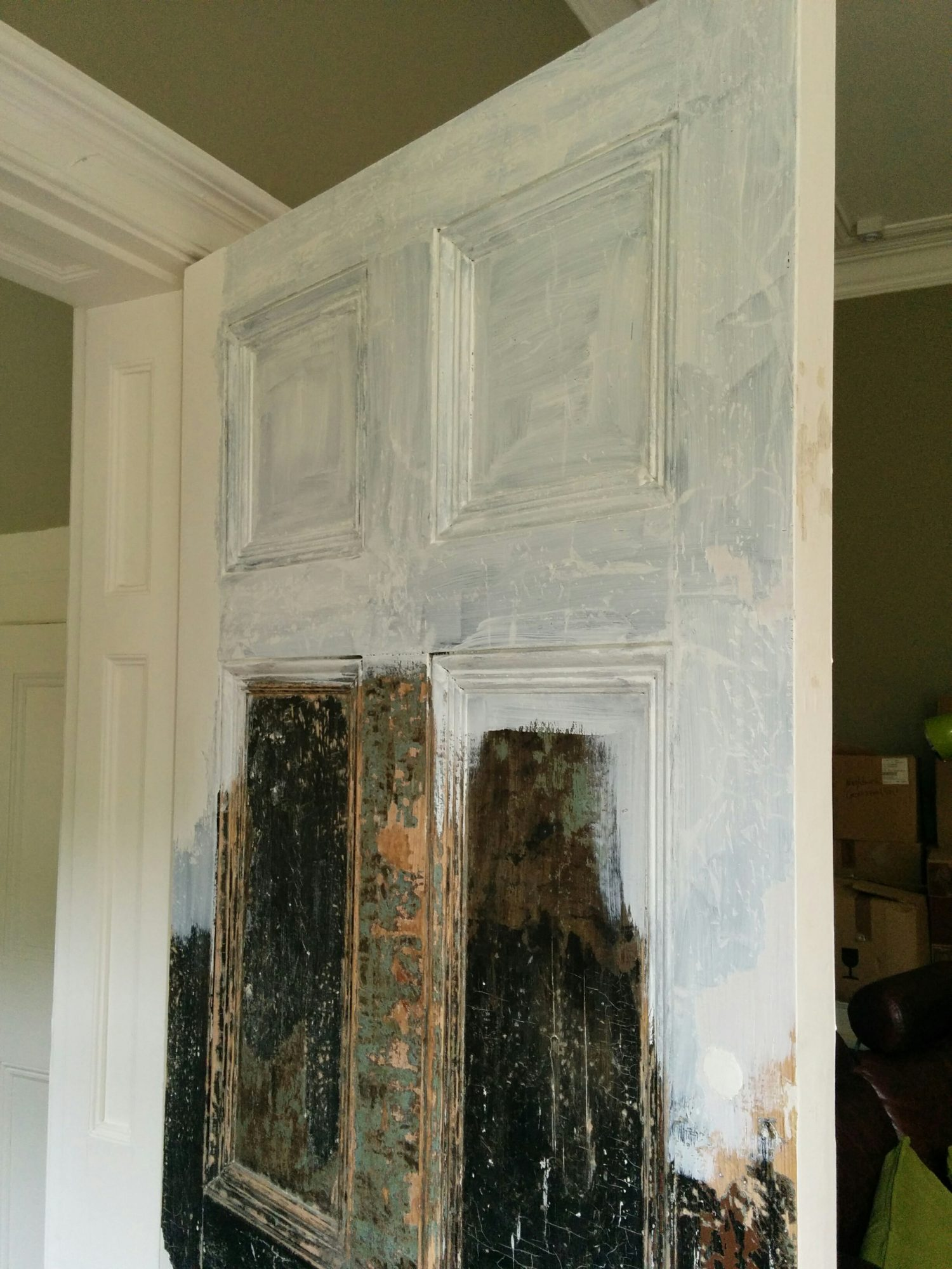 Living room door half painted