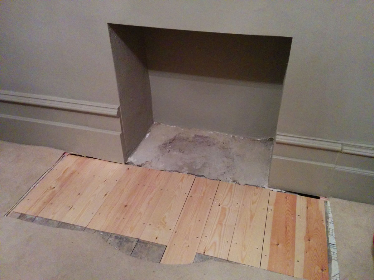 Living room fireplace awaiting its fire