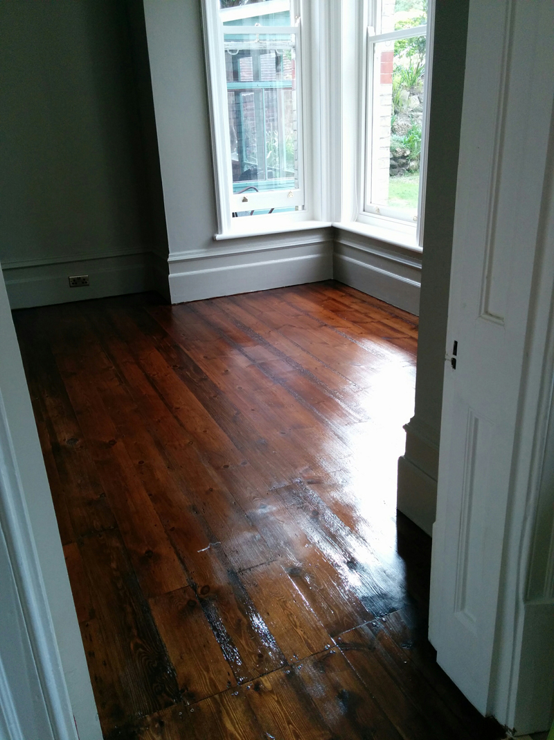 Living room floor after sanding & staining