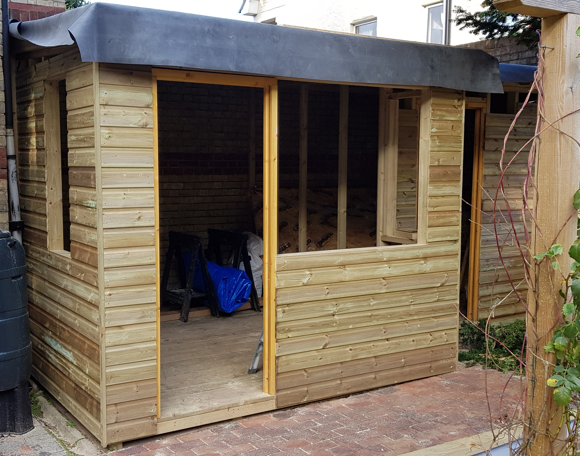exterior of potting shed clad
